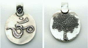 """Ohm"" pendant by Kris Kramer. Fine silver. Syringe drawing (left) and carving (right)."