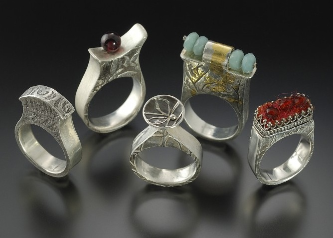Rings by Lora Hart. Fine silver with gold accents, beads, and felt.