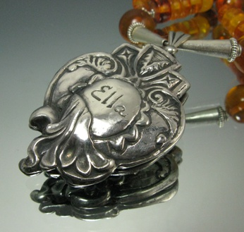 "Locket ""Treasured"" by Jeannette Froese LeBlanc. Fine silver and sterling silver."