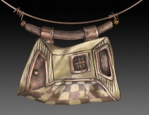 Pendant by Nellann Roberts. Copper and bronze.